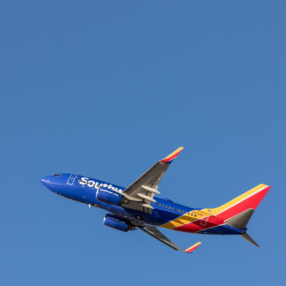 blue and red airplane on midair