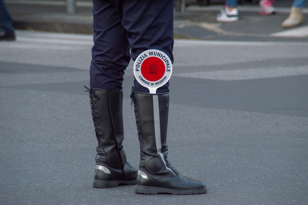 person wearinb lblack boots