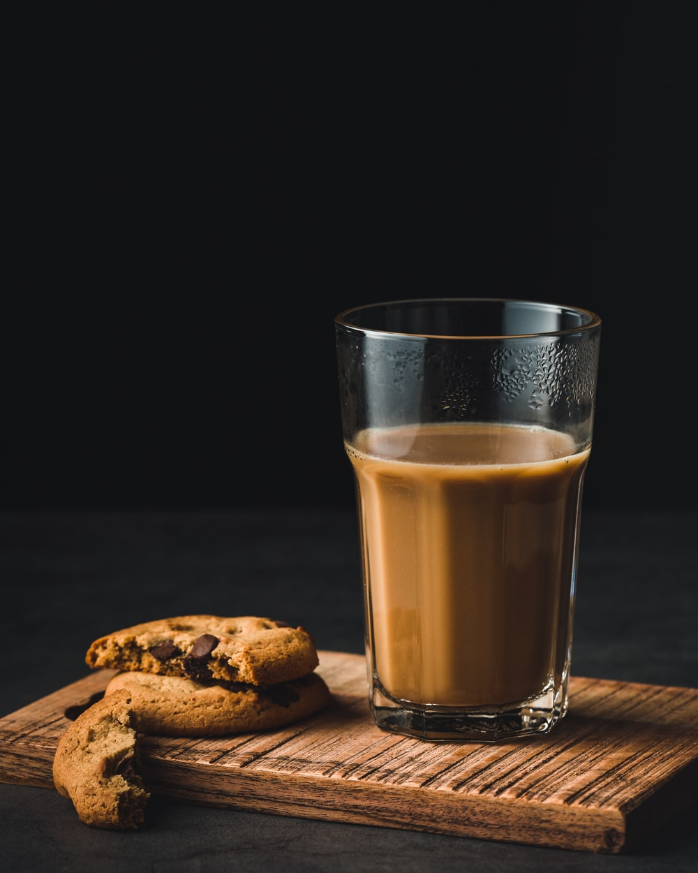 clear drinking glass and cookie
