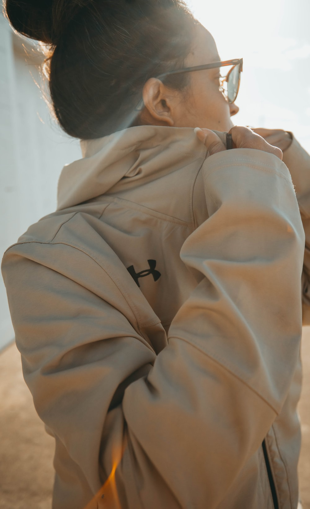 woman in beige Under Armour jacket during daytime