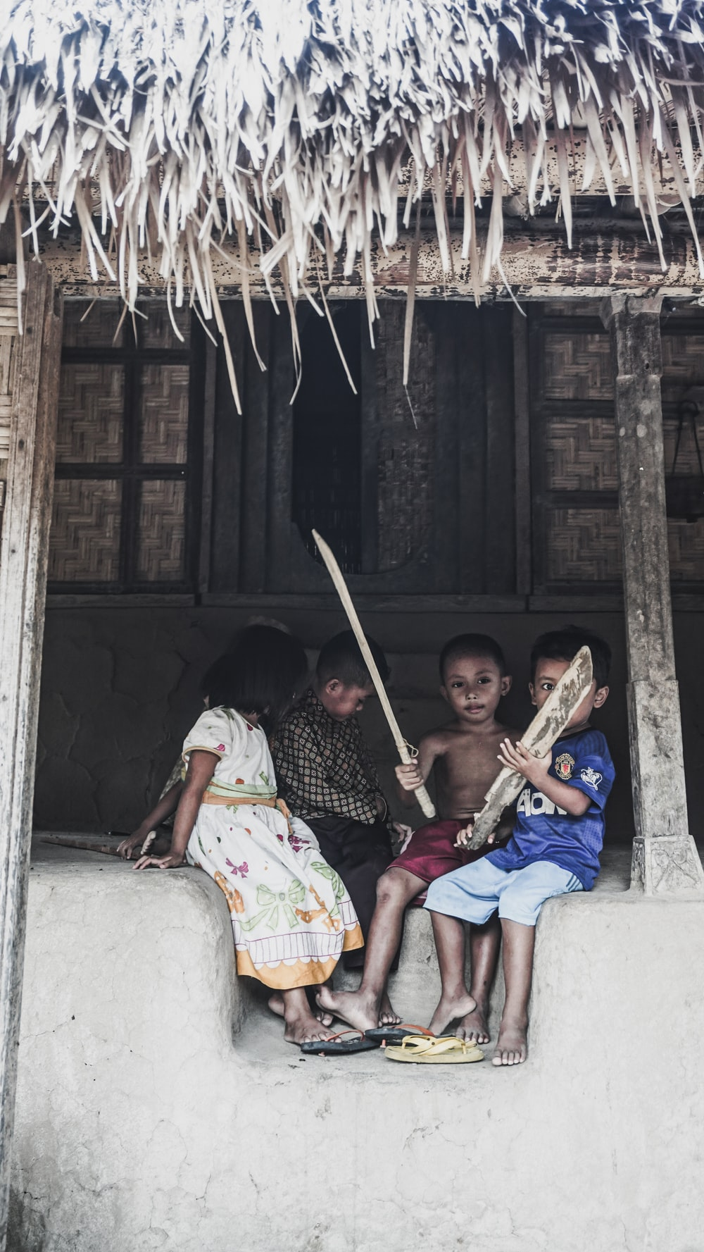 children playing with bamboo rods