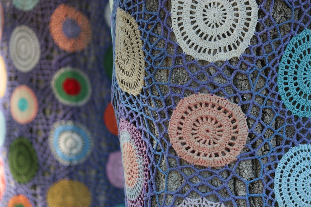 blue and multicolored textile