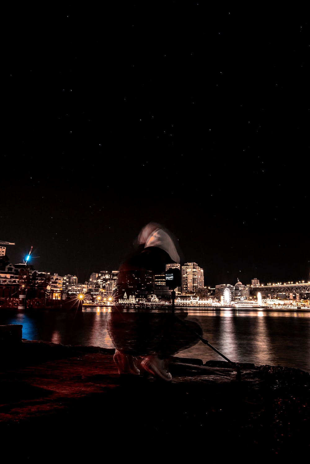 photography of building beside body of water during nighttime