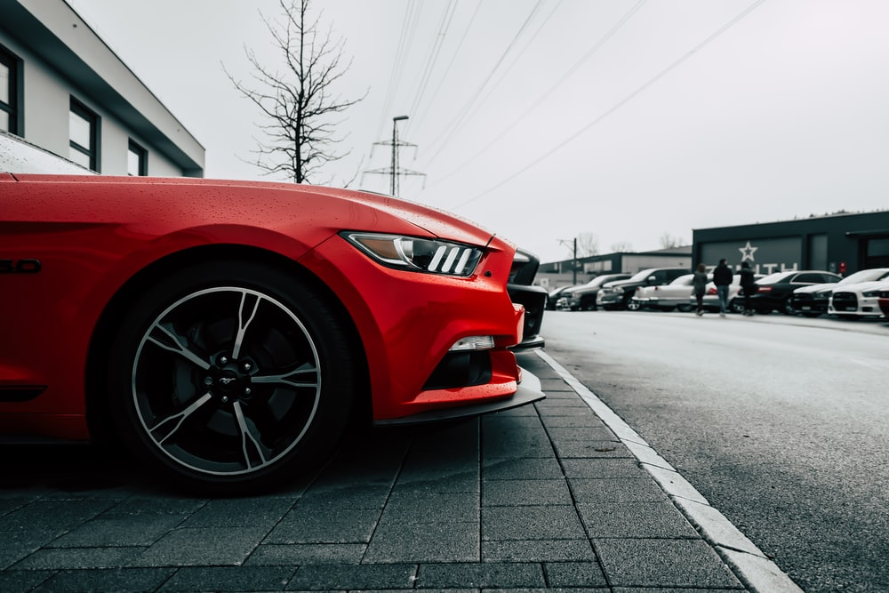 Parked Red Ford Mustang During Daytime
