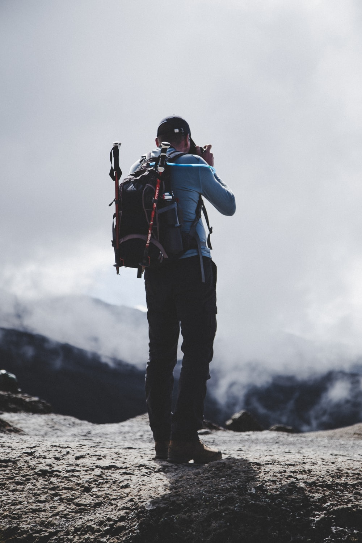 man taking photo of nature