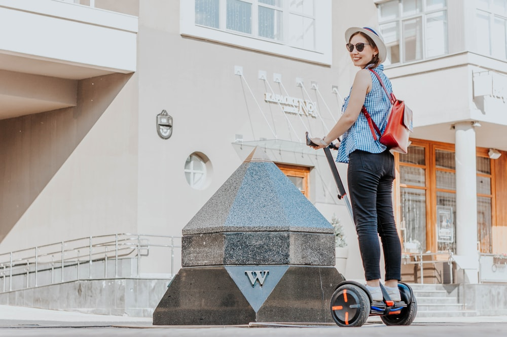 woman in a ride-on balancing board