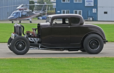 classic black car on road
