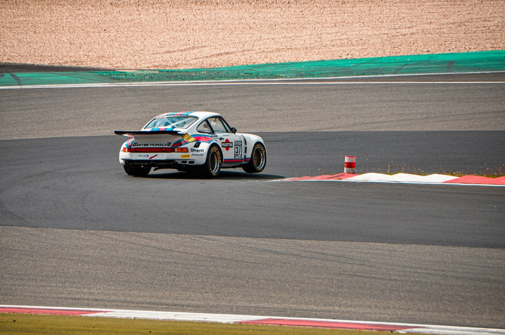 white sports car in a race track