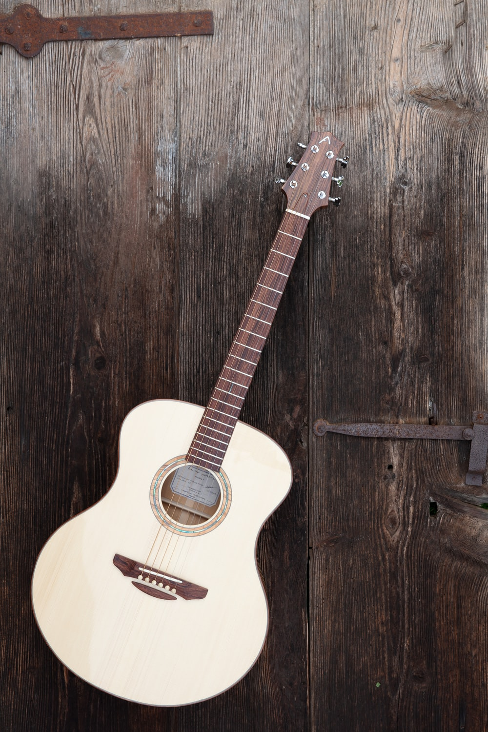white acoustic guitar