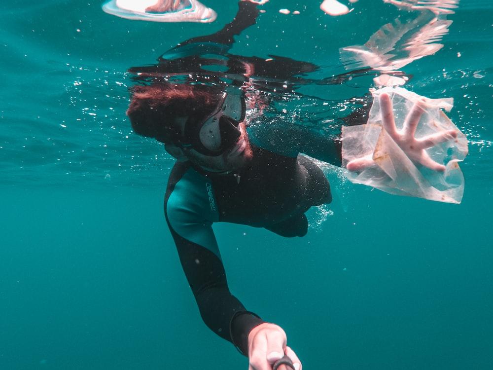 man swimming underwater