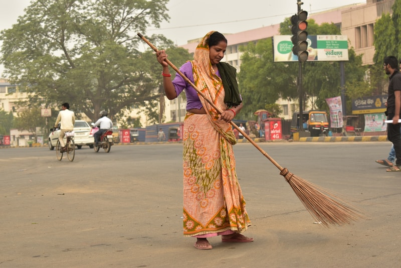 woman holding broom stick during daytime