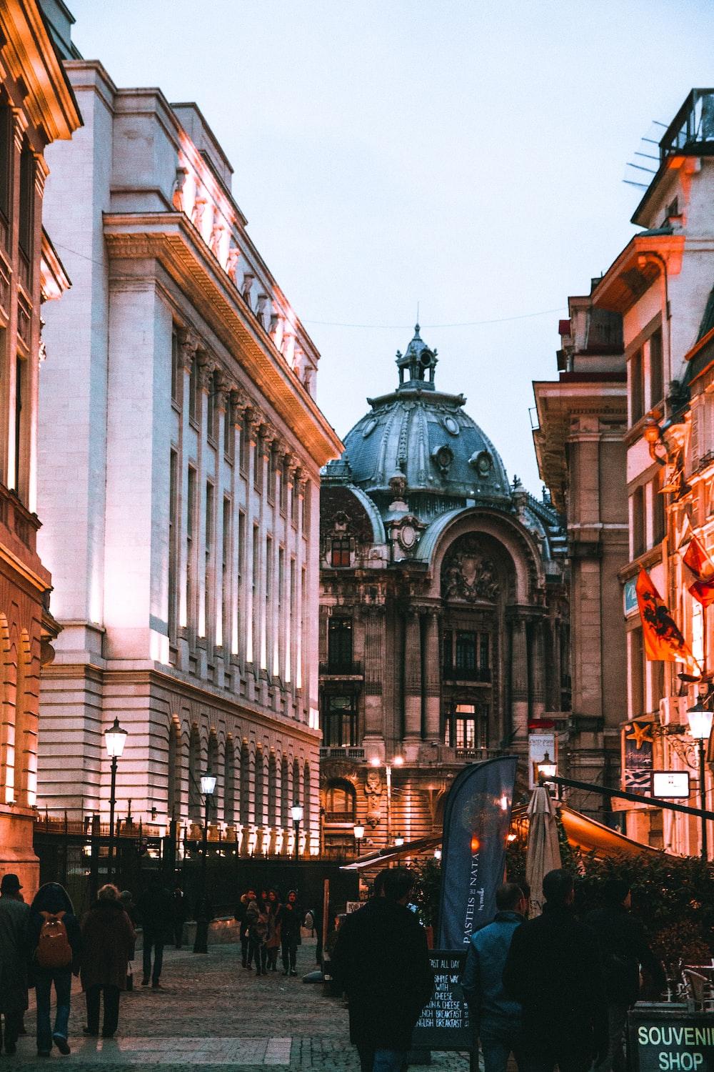 people walking beside buildings