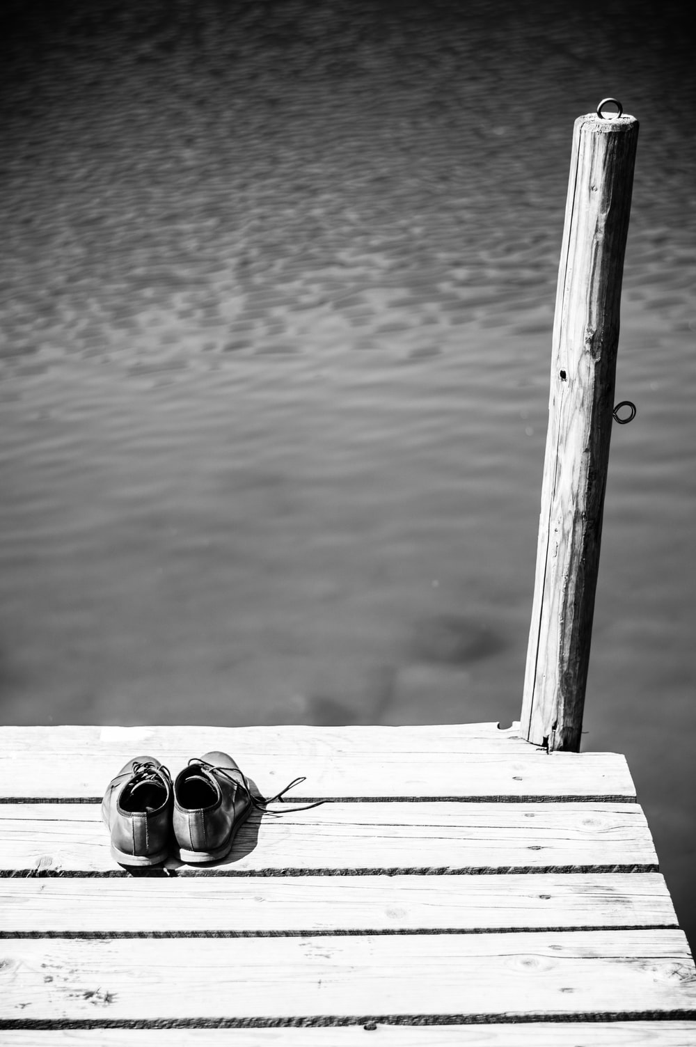 pair of shoes on dock