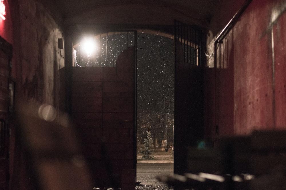 open metal gate leading outside
