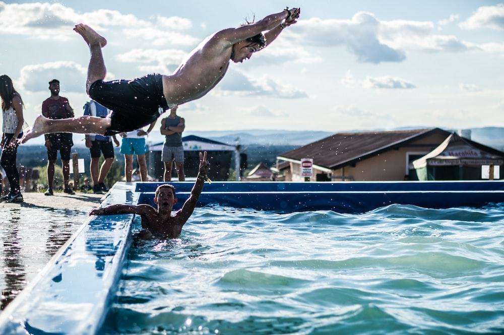 people near swimming pool