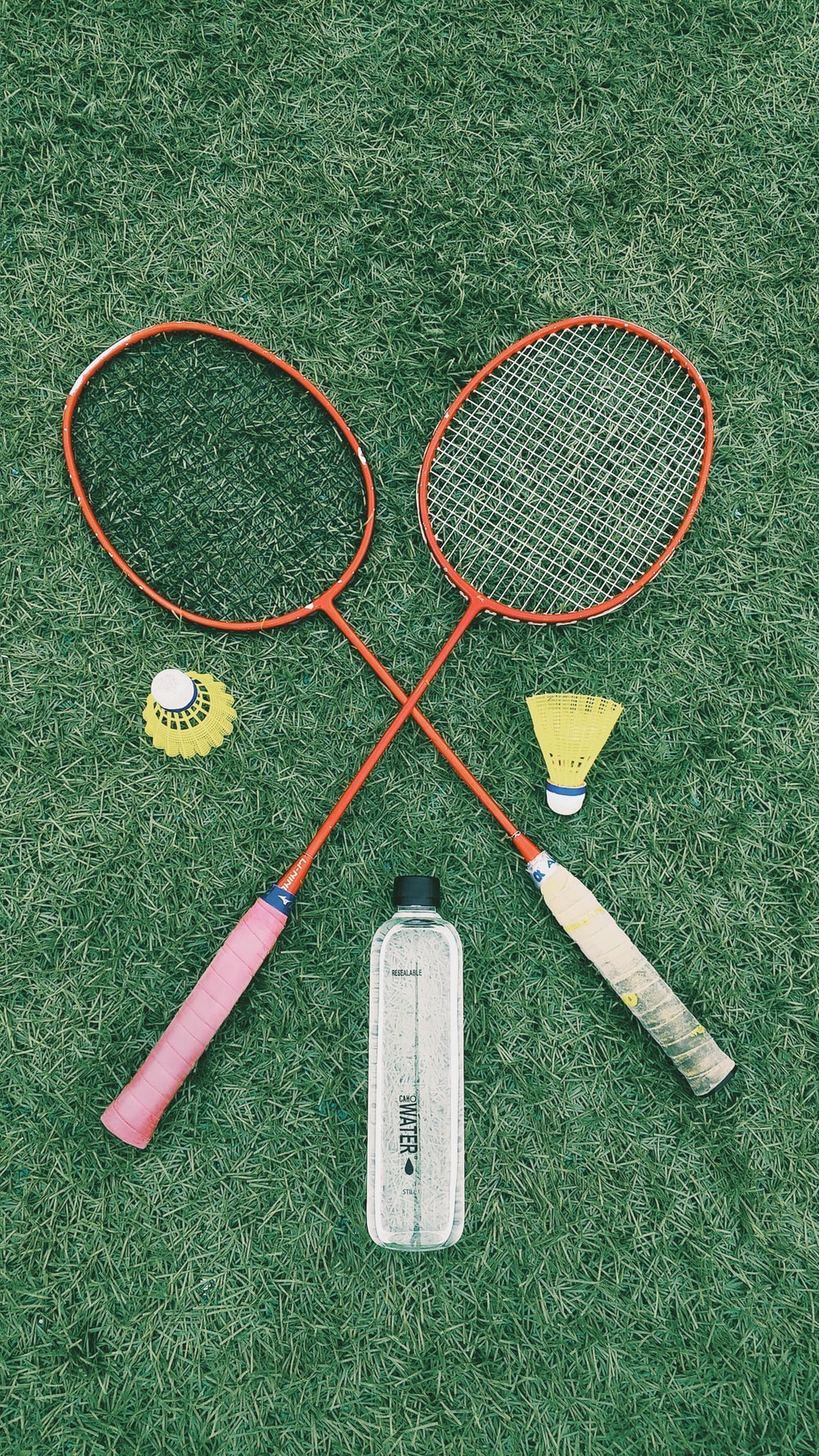 pair of red badminton rackets