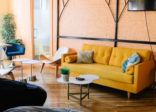 yellow sofa near wall