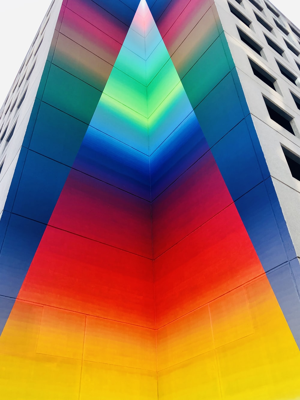multicolored building in low-angle photography