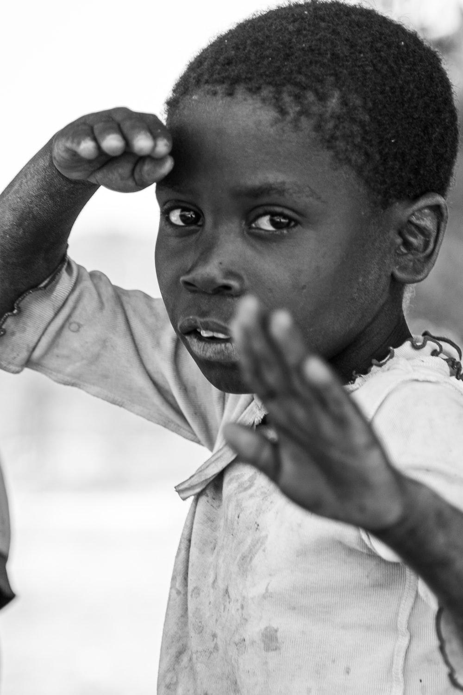 greyscale photography of boy