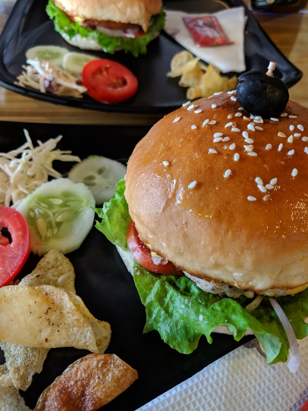hamburger with vegetables beside fruits