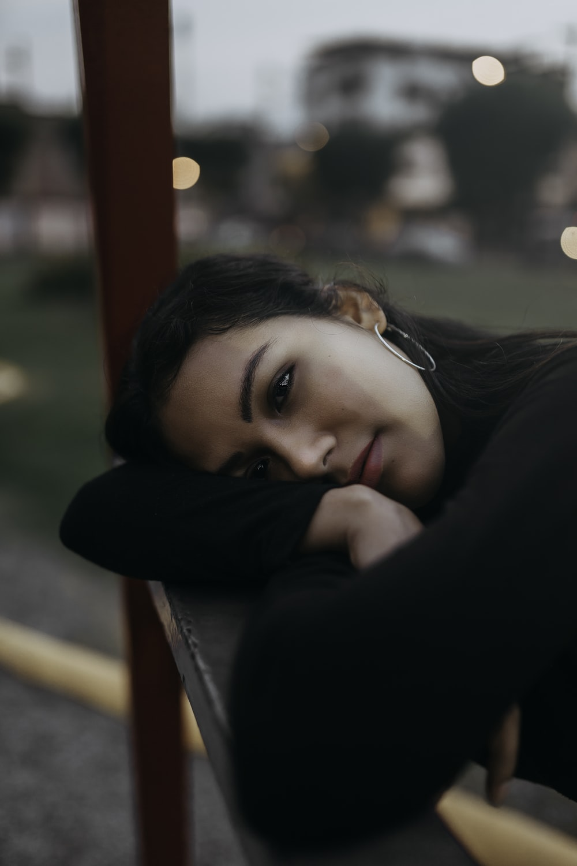 woman lies on bench
