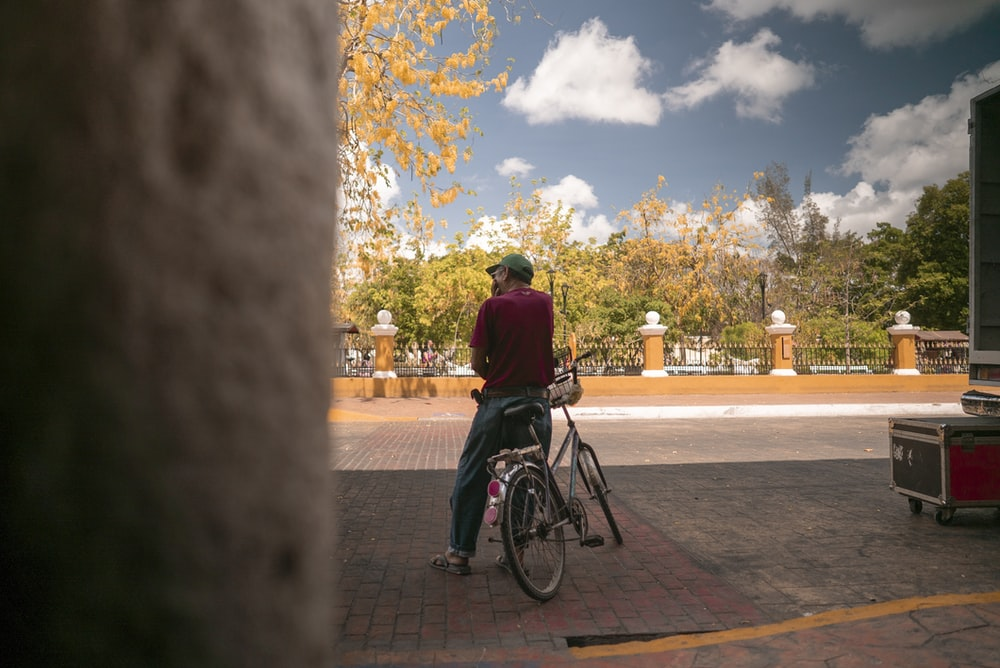 man sitting on bike