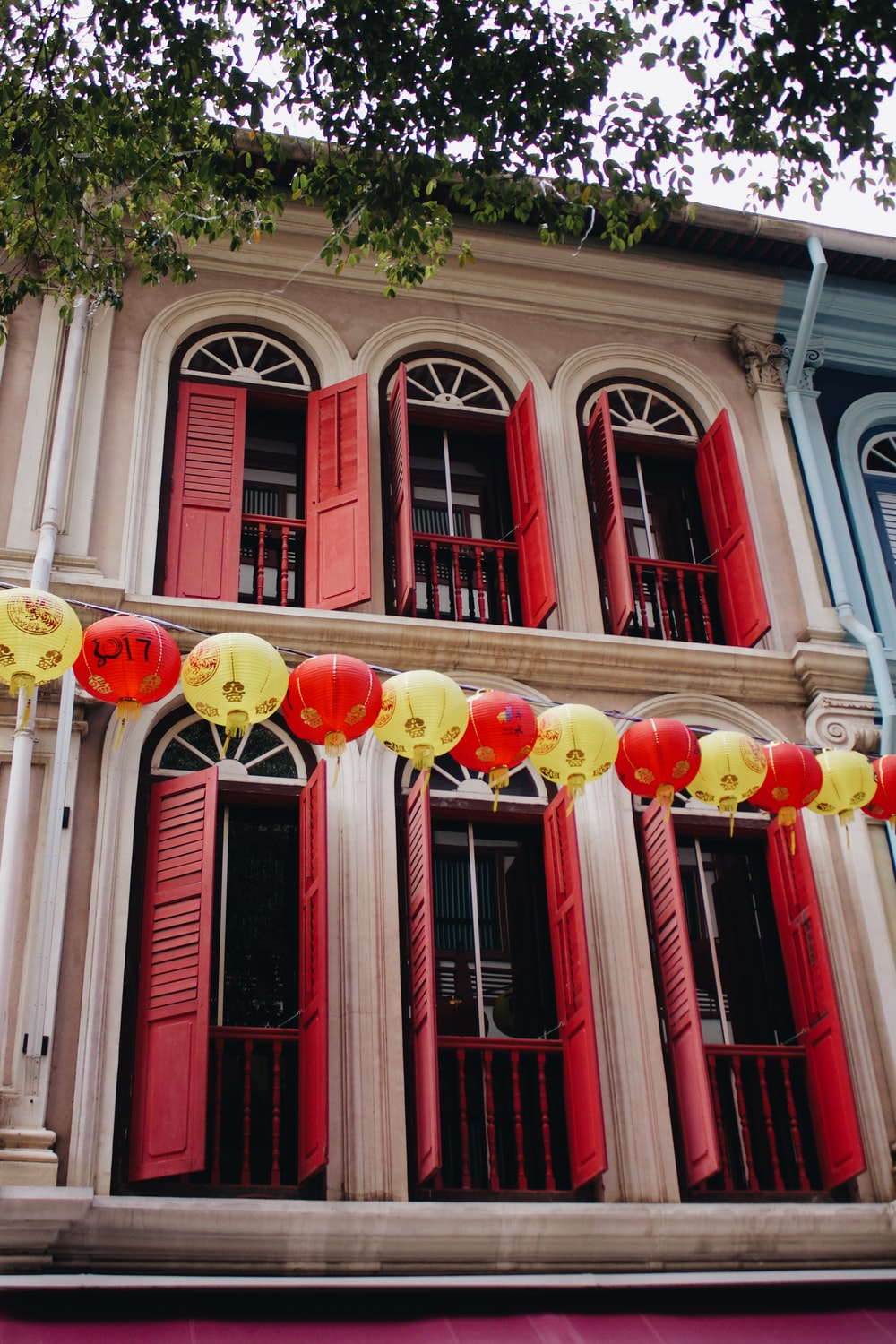 yellow and red ball lantern string outside building