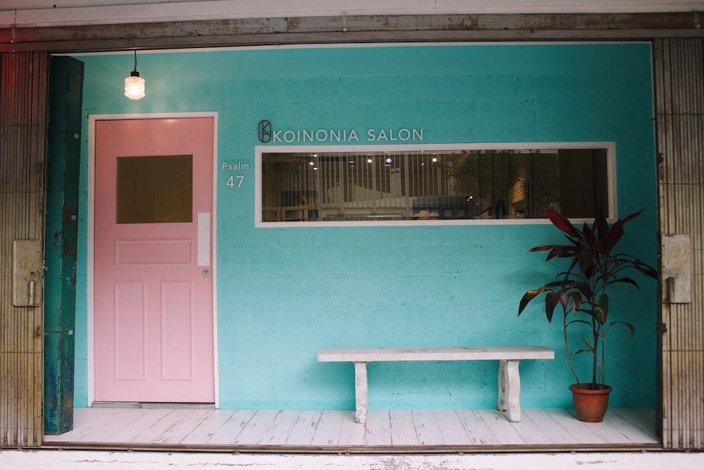 closed pink wooden door