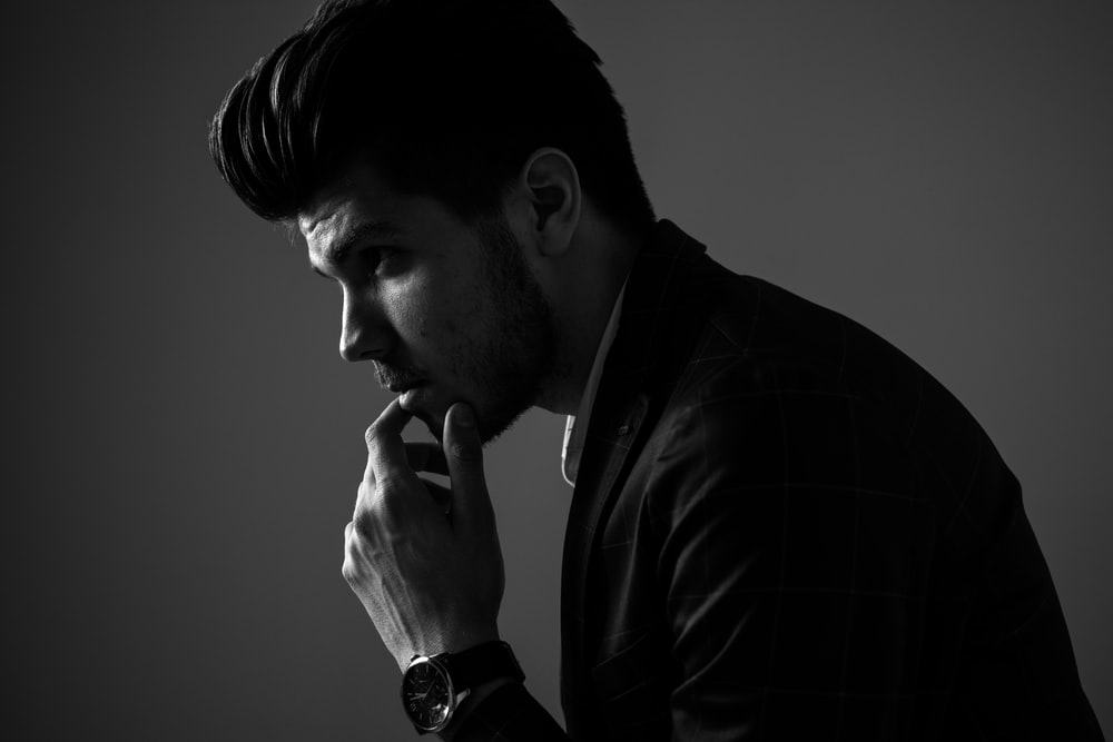 grayscale photography of man wearing blazer