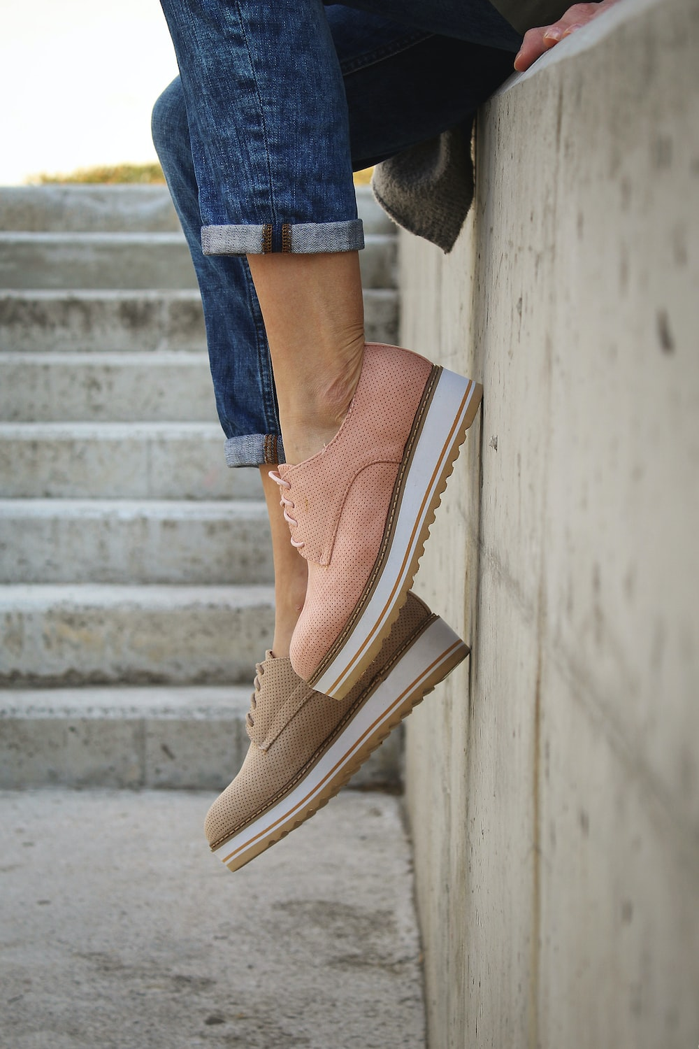 person wearing brown loafers