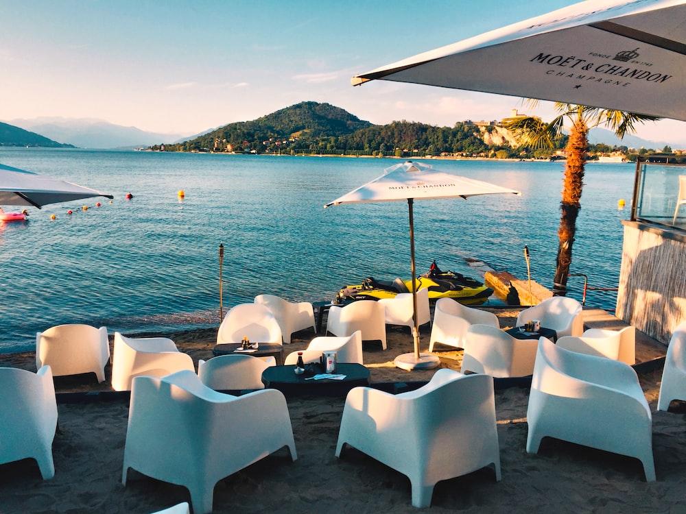 white chairs beside sea