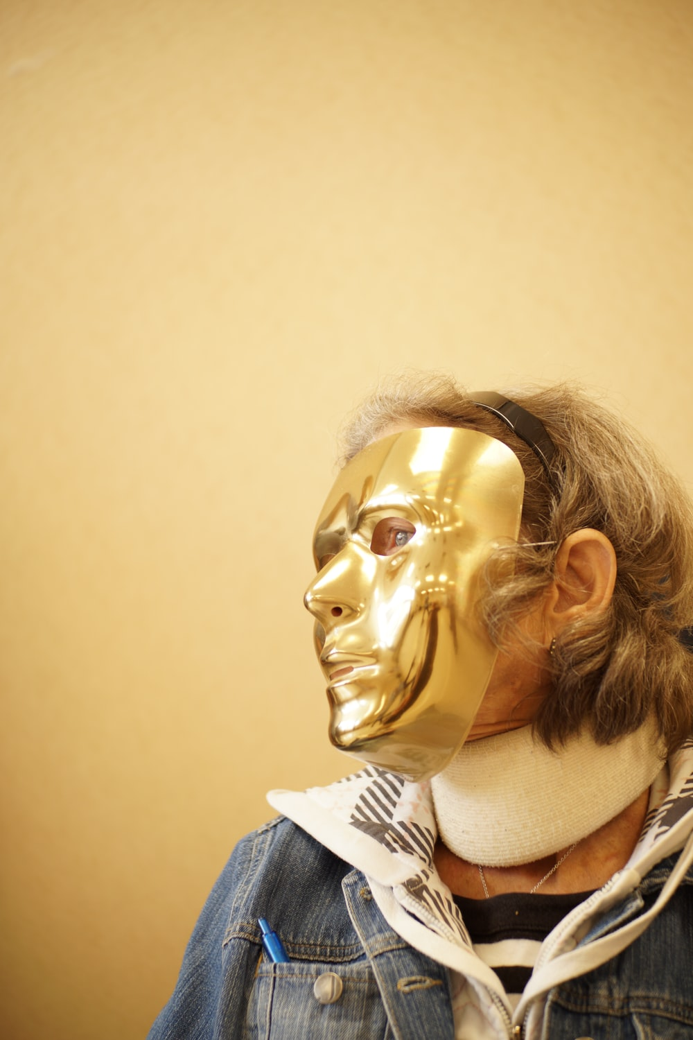 person wearing gold mask