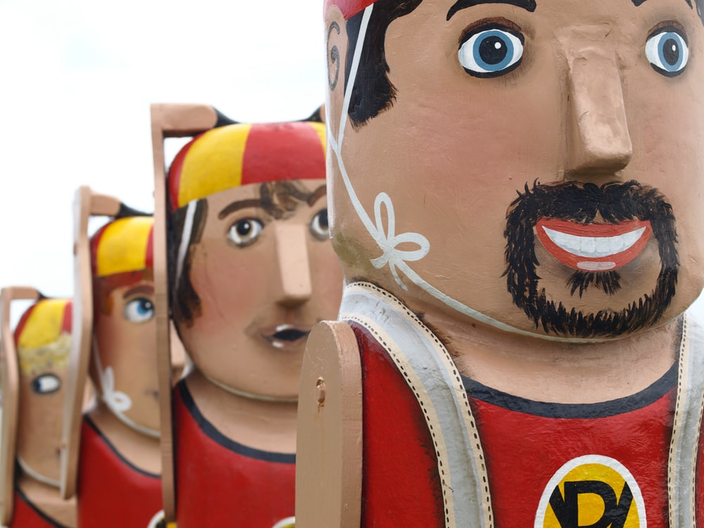 four person wooden dolls