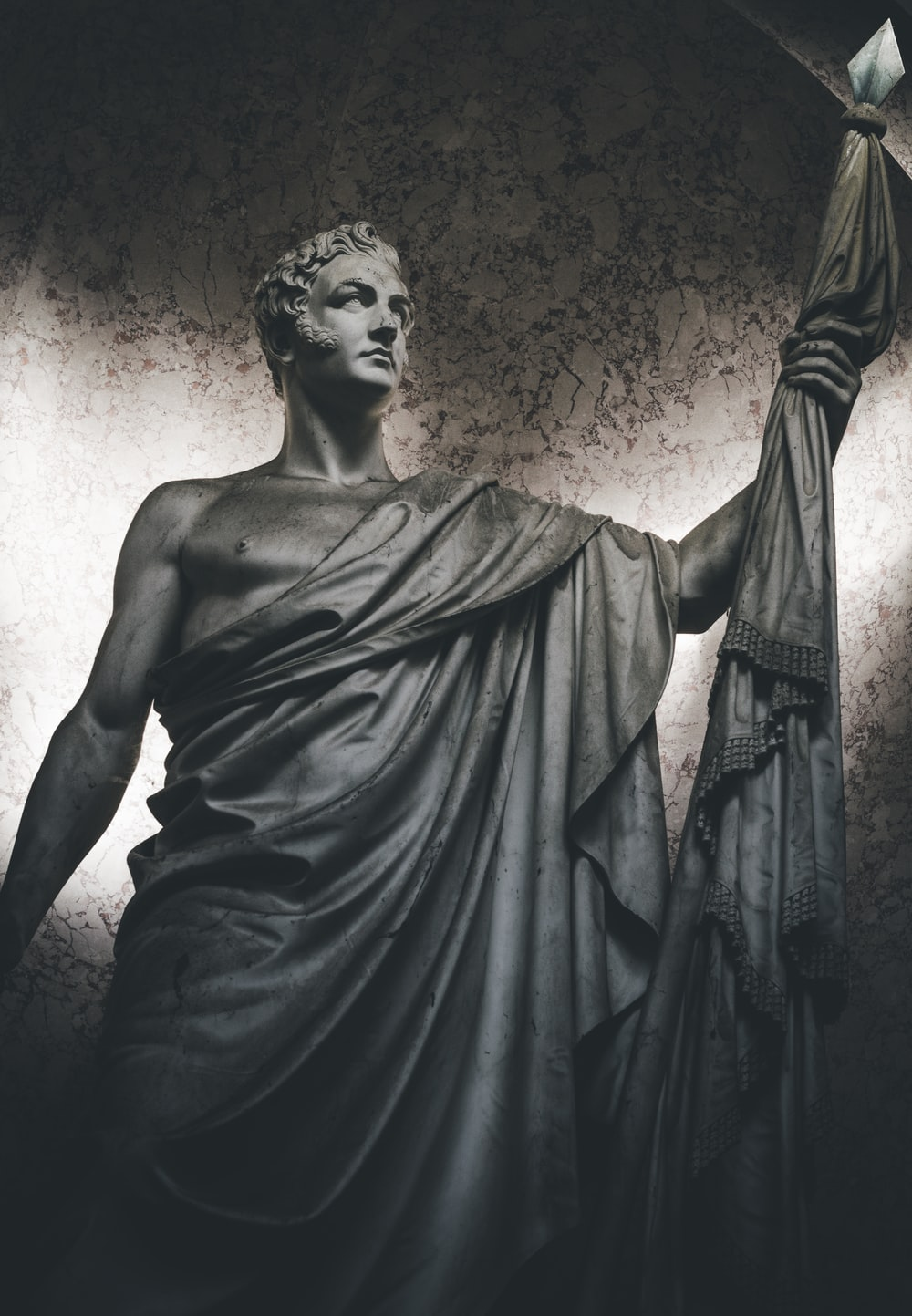 man holding spear statue