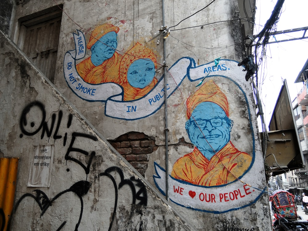 man wearing eyeglasses wall art