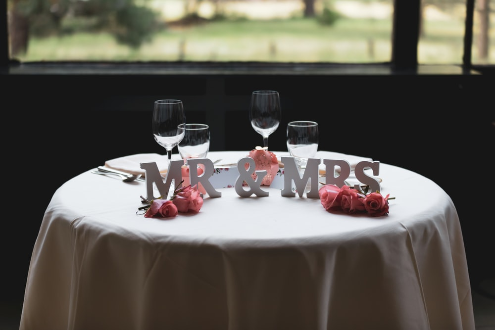 Mr & Mrs freestanding letter on table with four wine glasses
