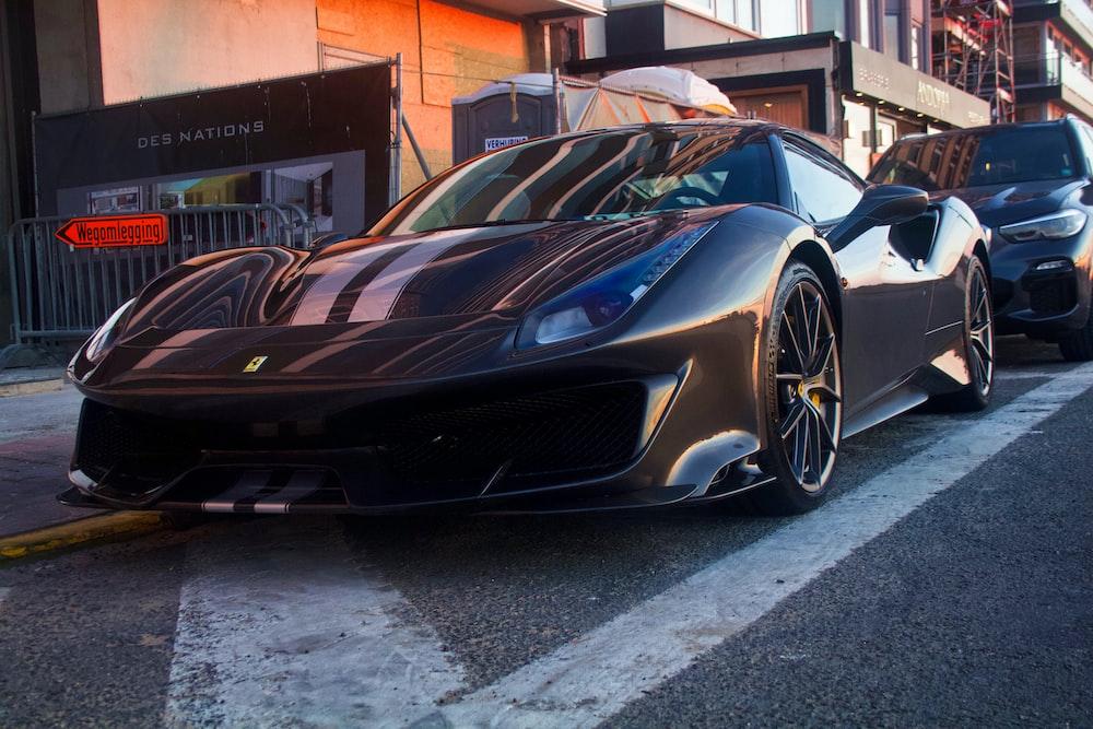 black sports car on sidewalk