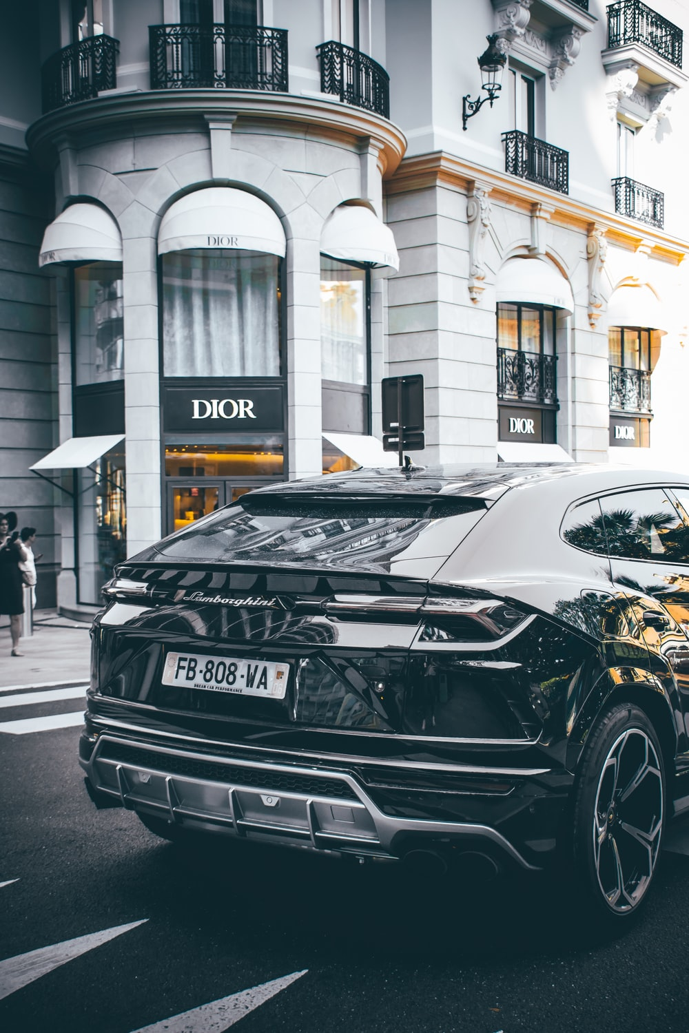 black car photo across Dior store