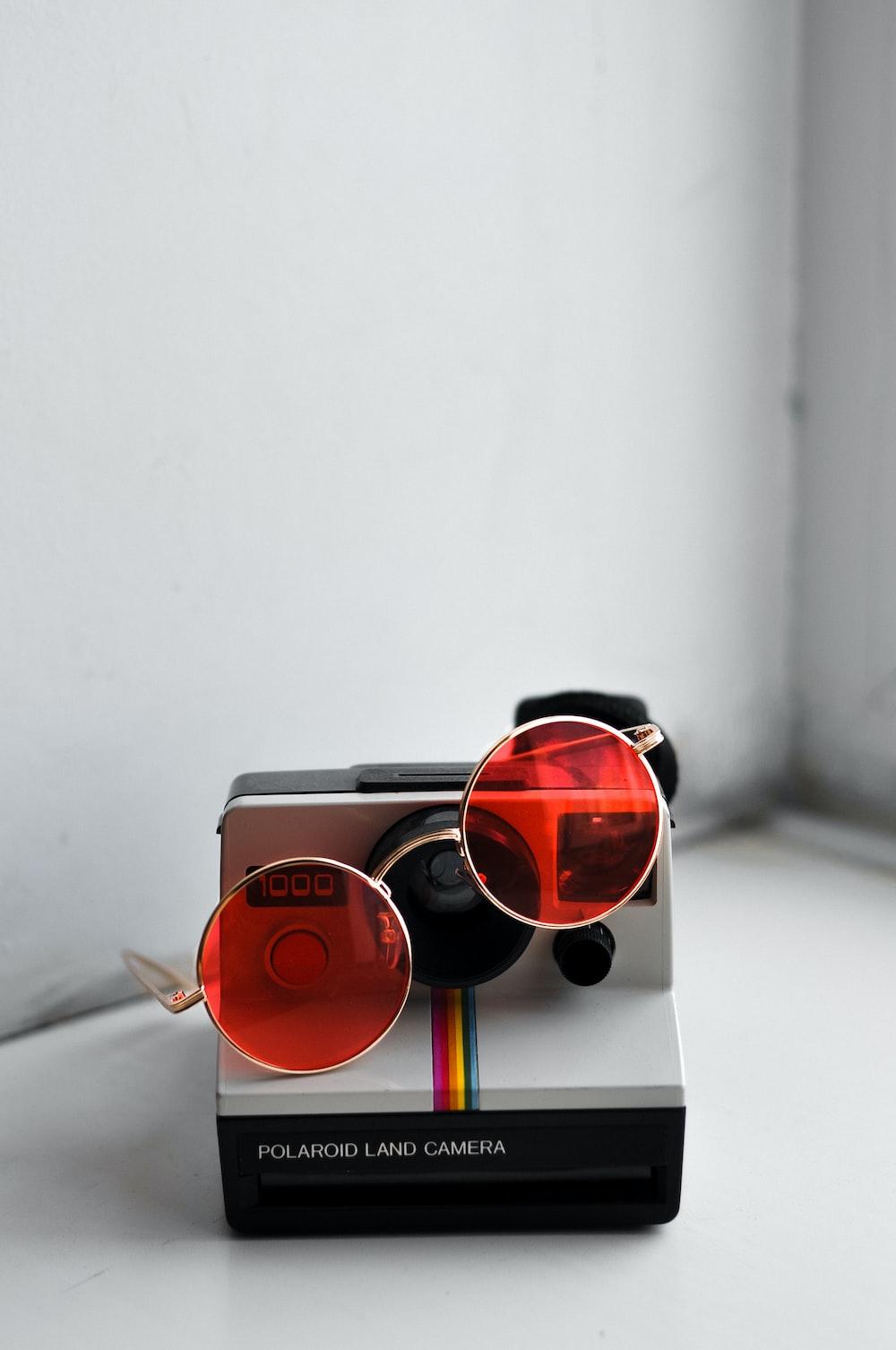 gold-framed red hippie sunglasses