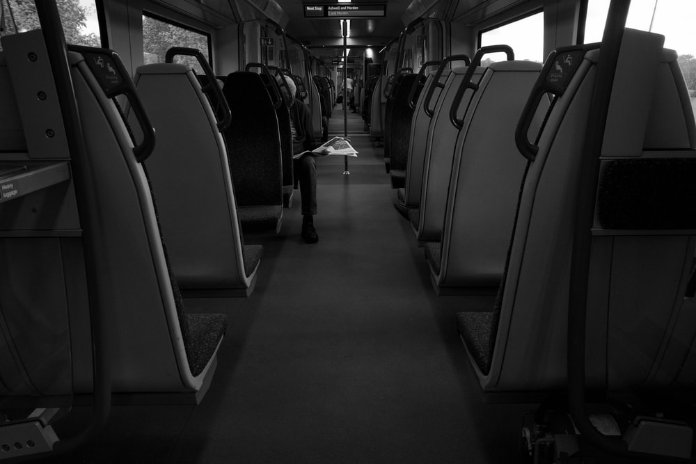 grayscale of a bus interior