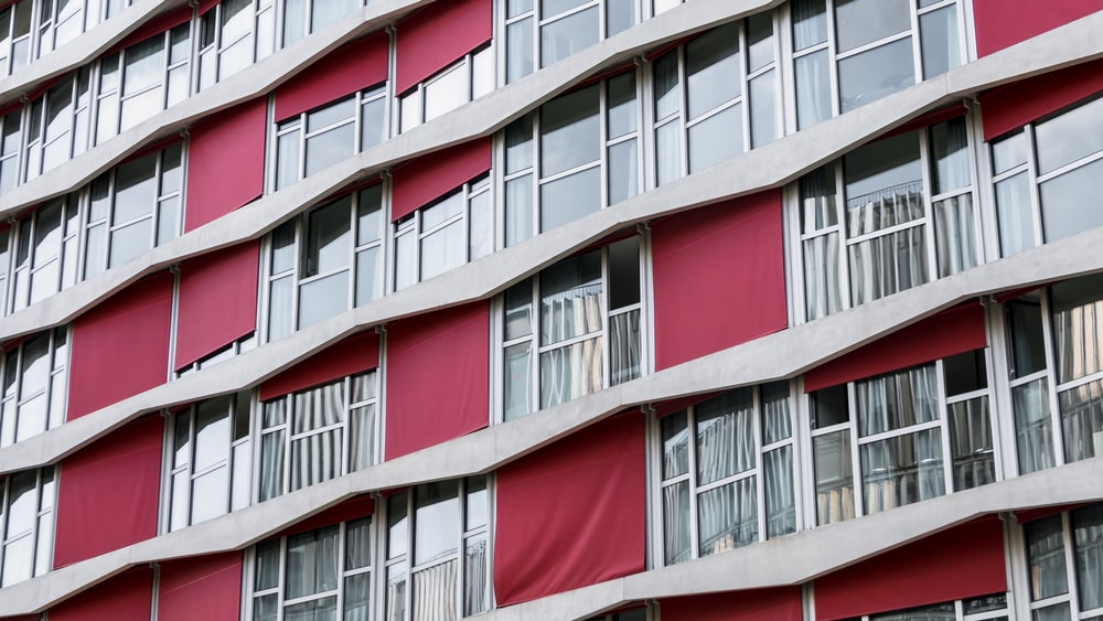 red and gray painted building windows