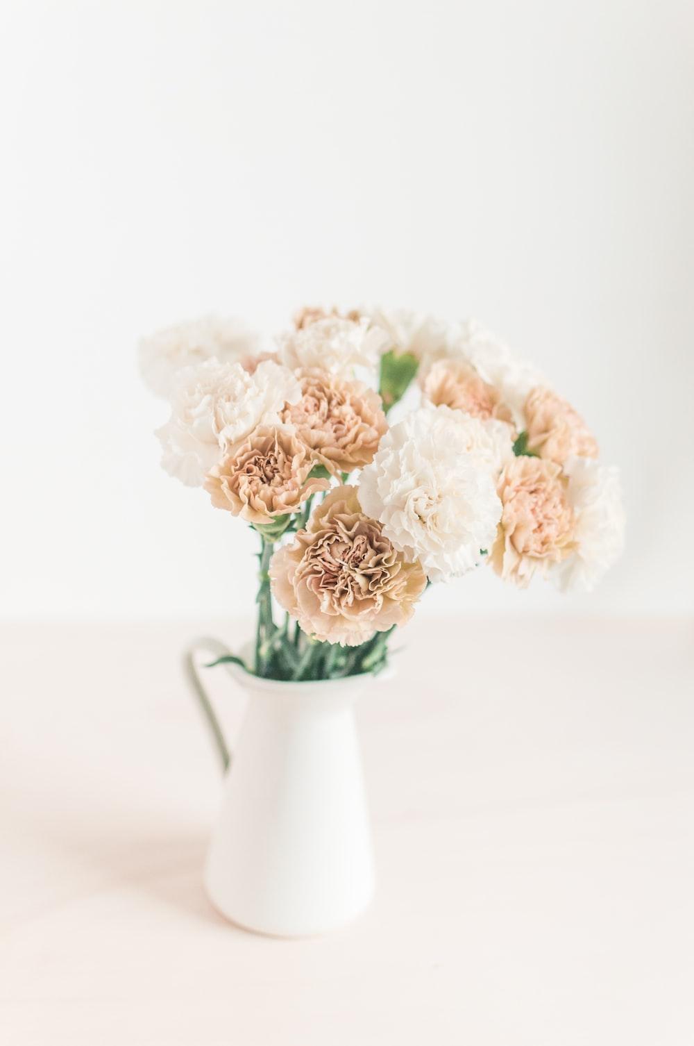 white ceramic flower pitcher
