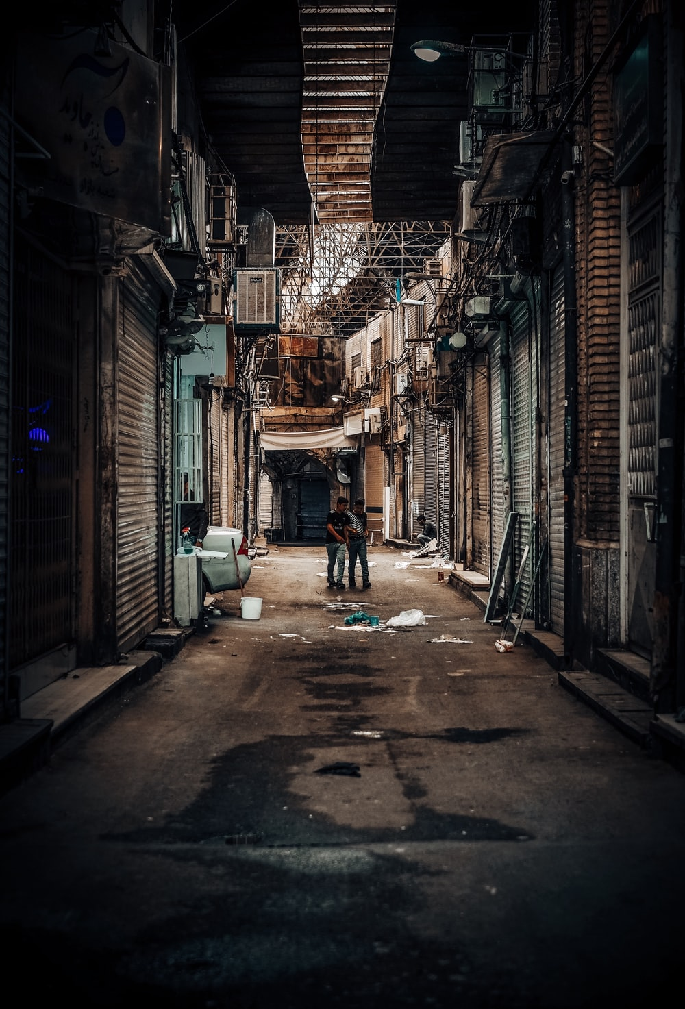 two men walking on street photo