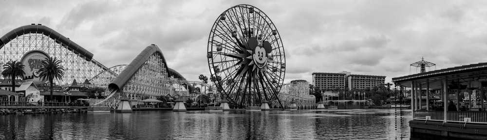 grayscale panoramic photography of Mickey Mouse ferris wheel
