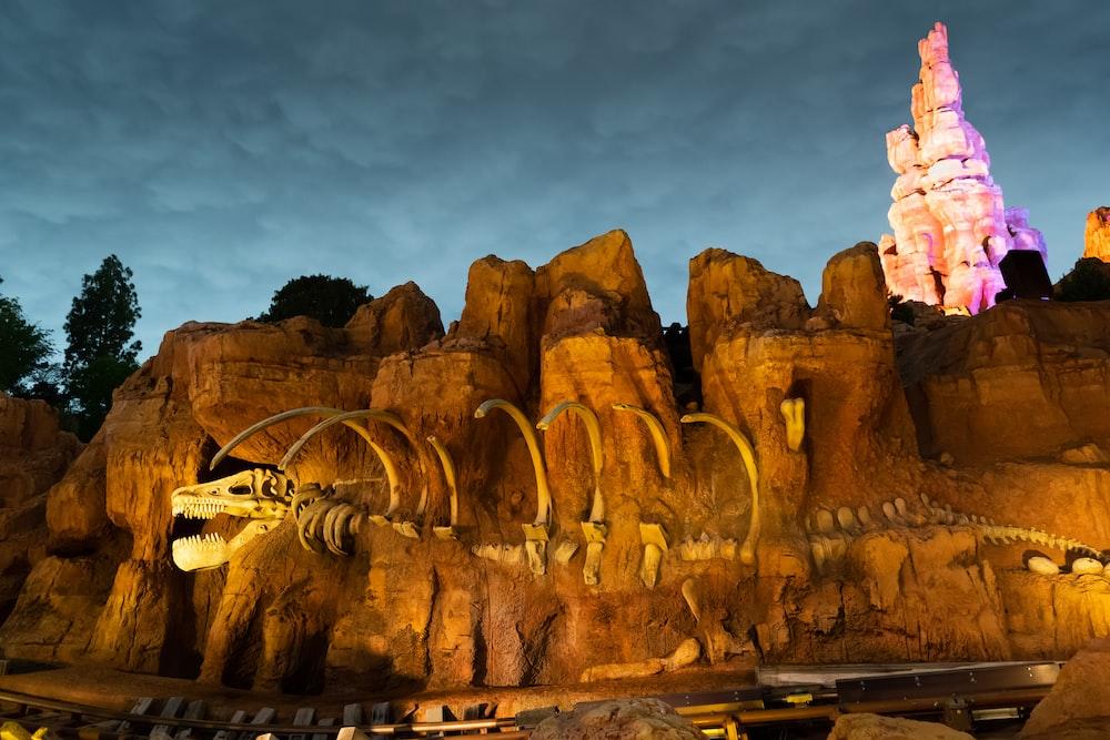 dinosaur skeleton in mountain at the park during night