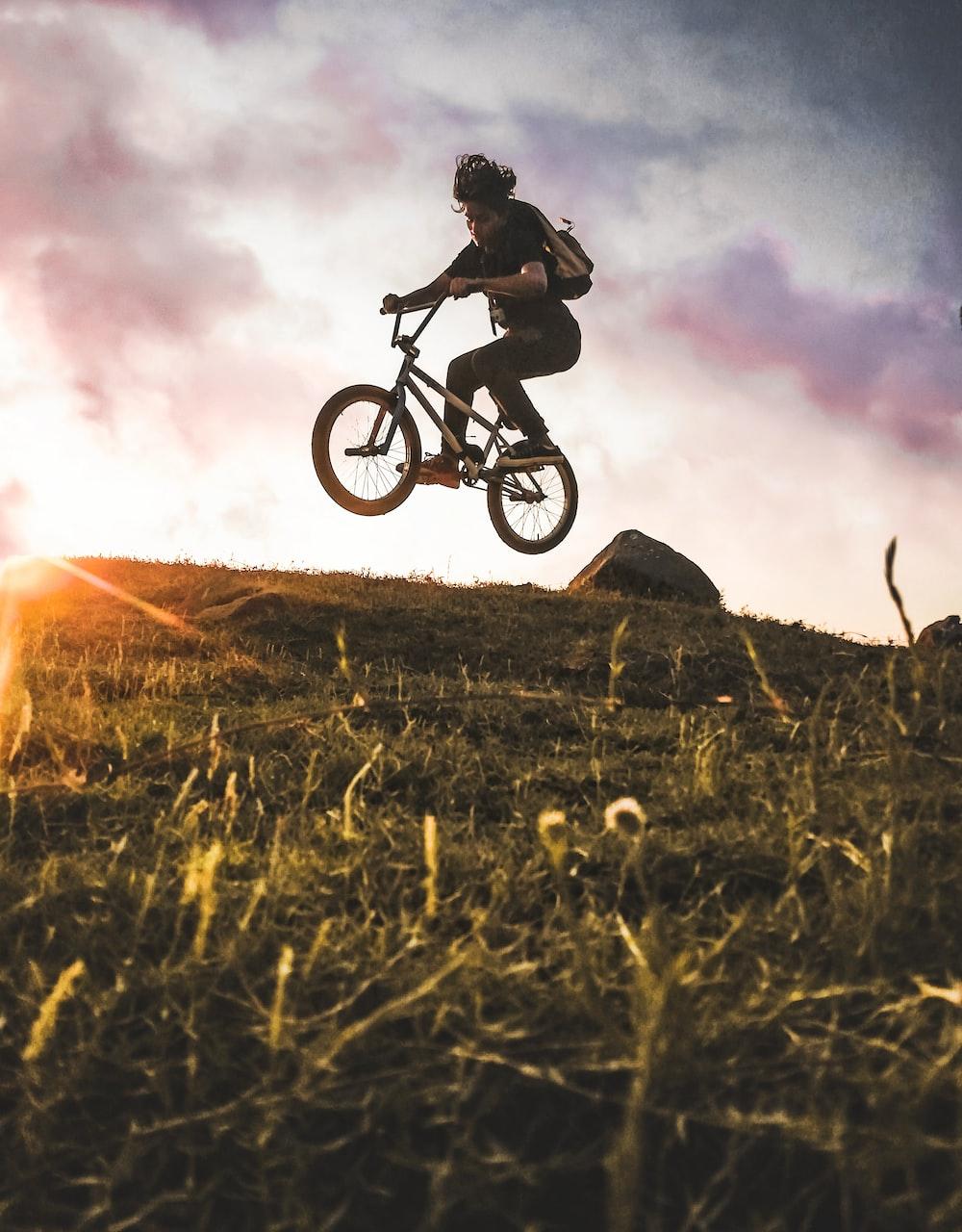 woman riding BMX bike at the hill