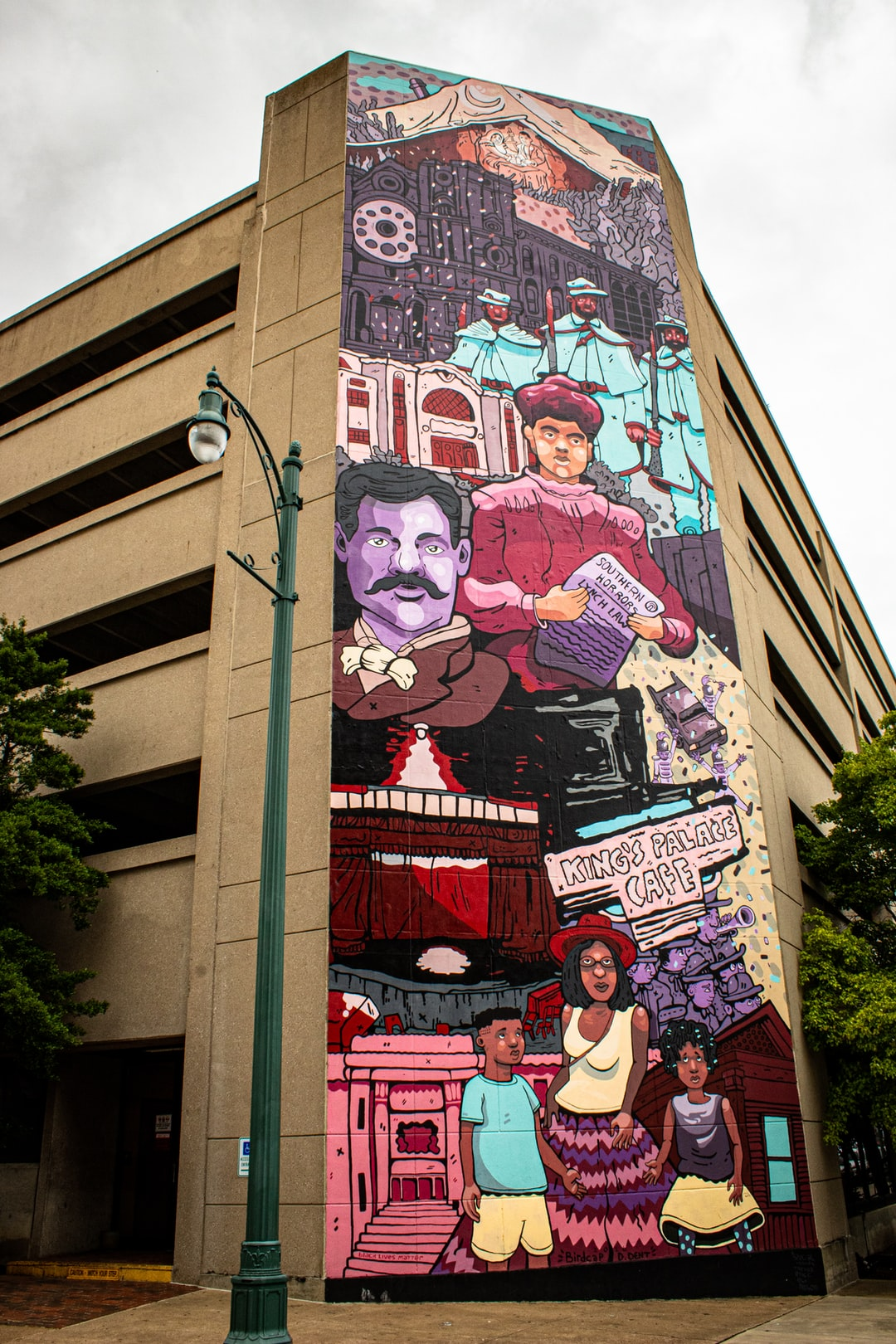 A mural on the side of a parking garage in downtown Memphis, TN, along Main Street.