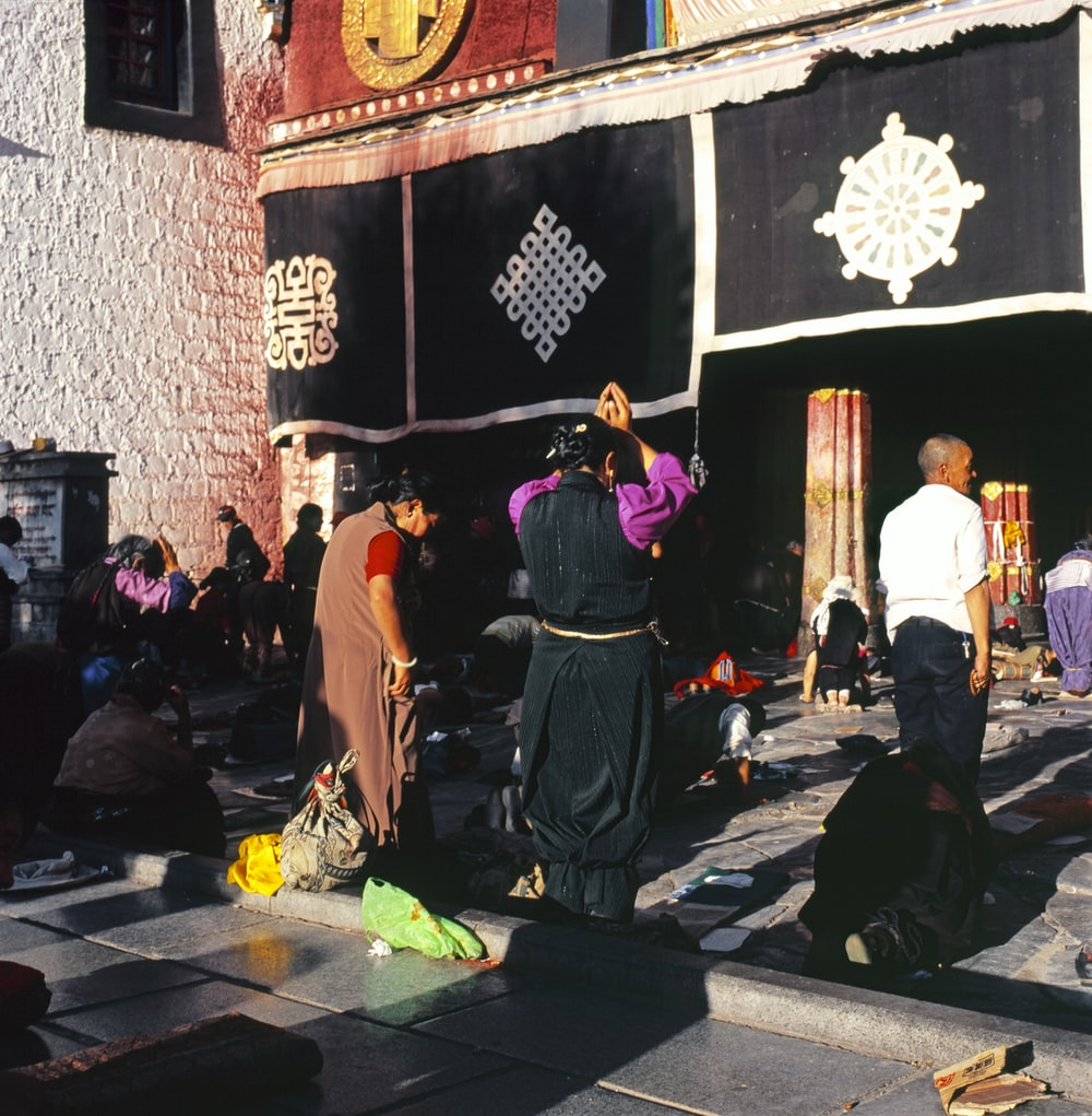 people praying outside temple