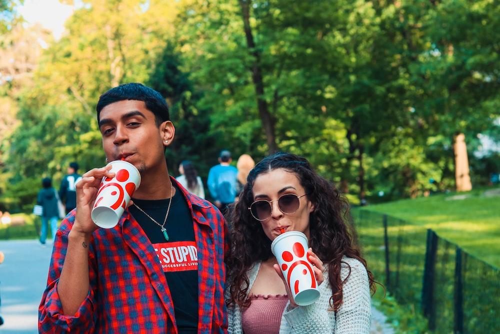 man and woman drinking soda