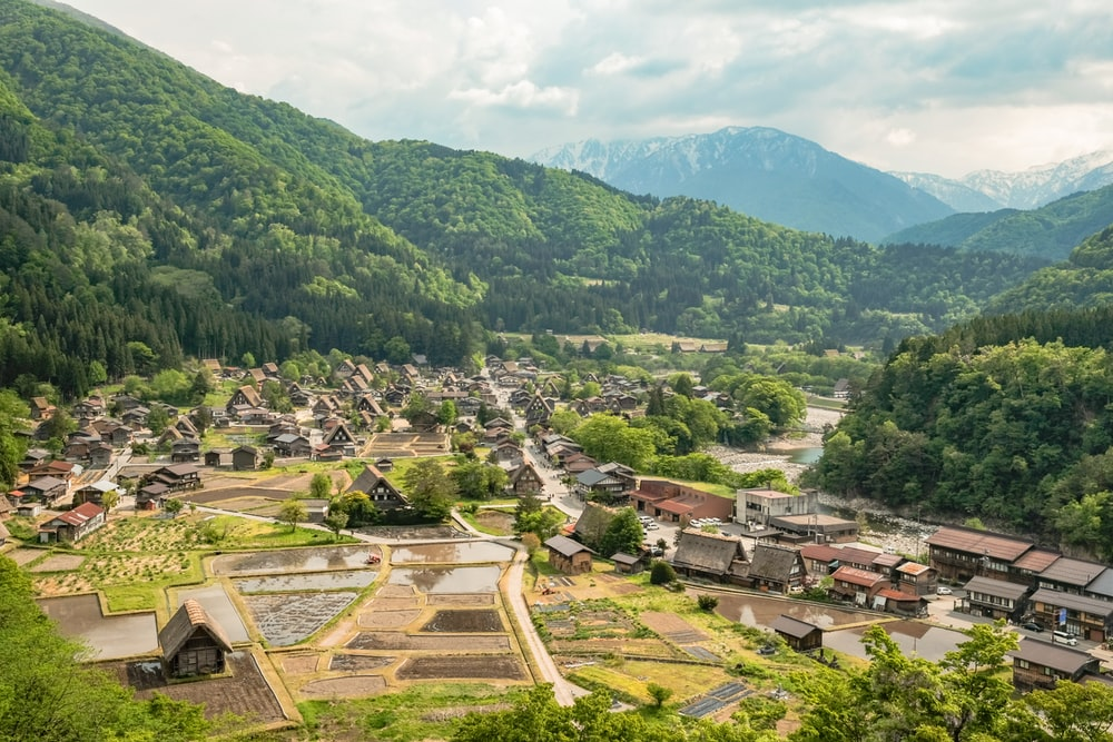 houses and rice paddies at the valley with river